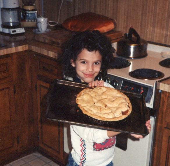 My hair that Santa found attractive. He was kind enough not to comment on my chapped lips. Clearly my aversion to sweets had not started yet in this photo as I had yet to be denied my ice cream machine. Also, it's clearly the 80's.