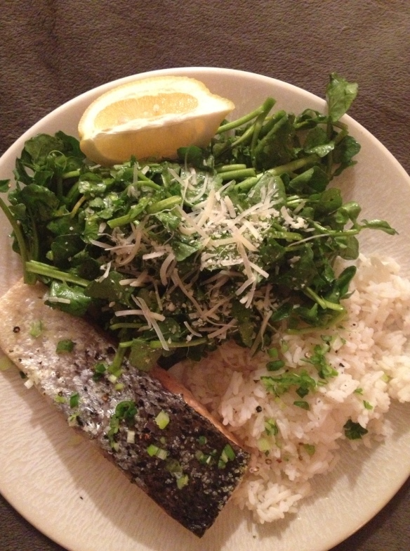 Salmon with watercress salad and rice.